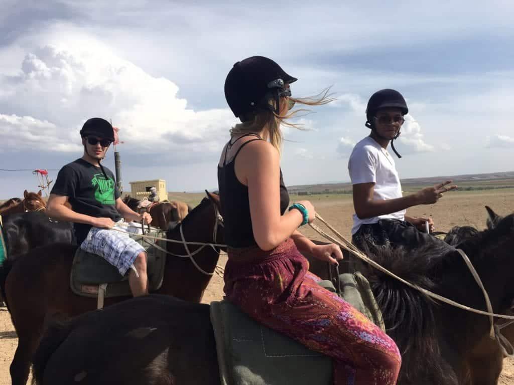Ashely riding on horseback in Mongolia, 2017. Photo courtesy of Ashely Lipasek.